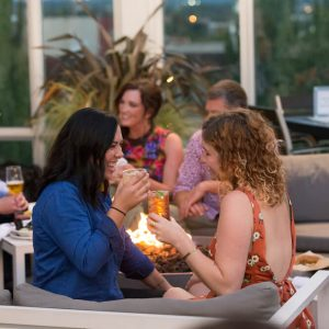 Two women with cocktails on the Altabira patio