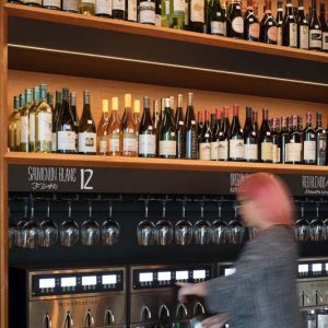 Pullman Winebar & Merchant, women dispensing specialty wine by the glass